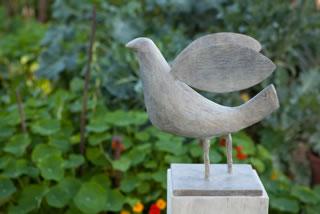proud bird on plinth